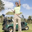 Beautiful golf player with her bogey — Stock Photo #31323339