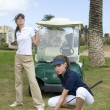 Two woman playing golf — Foto de Stock