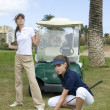 Two woman playing golf — ストック写真