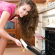 Woman cooking in the kitchen  — Foto Stock
