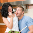 Couple playfully eating salad — Stock Photo
