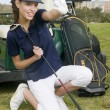 A pretty woman golfer holding a golf ball — Stok fotoğraf