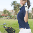 Beautiful player golf with her club and bag — Stock Photo #31323773