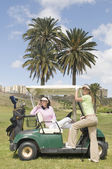 Two pretty golf player — Stock Photo