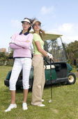 Two golf player with golf car — Stock Photo