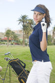 Beautiful player golf with her club and bag — Stock Photo