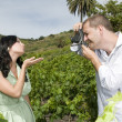 Young couple with camera in a vineyard — Stock Photo