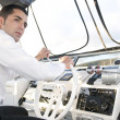 Man at yatch control — Stock Photo