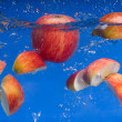 Apple under water — Stock Photo