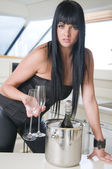 Woman with champagne bottle — Stock Photo