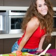 Beautiful woman preparing salad  — Stock Photo