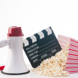 Pop corn,film reel and clapper board — Stock Photo