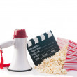 Stock Photo: Pop corn,film reel and clapper board