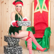 Santa claus assistant with presents — Stock Photo