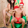 Sexy santa claus couple — Stock Photo
