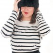 Girl in a striped blouse and fur hat — 图库照片