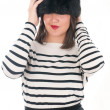 Girl in a striped blouse and fur hat — Stok fotoğraf