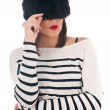 Girl in a striped blouse and fur hat — Stock Photo #38090767