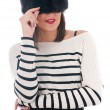Girl in a striped blouse and fur hat — Stock Photo #38090775