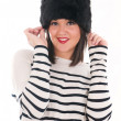 Girl in a striped blouse and fur hat — ストック写真
