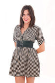 Girl in a checkered dress — Stock Photo