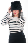 Girl in a striped blouse and fur hat — Stock Photo