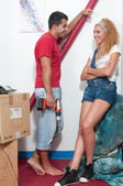 Couple working in their new home — Stock Photo