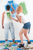 Couple painting at home — Stock Photo