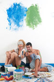 Couple tired after painting at home — Stock Photo
