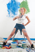 Woman painting at home — Stock Photo