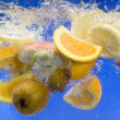 Stock Photo: Fresh fruit splashing in fresh water