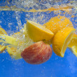Stock Photo: Fresh fruit falling in water