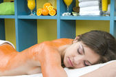Woman getting a fruit massage — Stock Photo