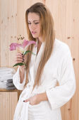 Woman with flower in spa — Stock Photo