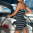 Pretty young girl posing on a yacht — Stock Photo #47584207