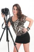 Woman with tripod and camera — Stockfoto