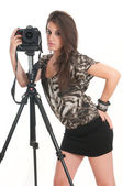 Woman with tripod and camera — Stock Photo