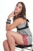 Sexy woman sitting on stepladder — Stock Photo