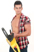 Sexy man with electrical saw — Stock Photo