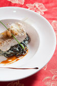 Fish with seaweed salad — Stock Photo
