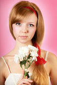Beautiful woman with flowers on pink background — Stock Photo