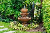 Fountain in garden — Stock Photo