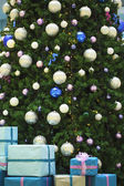 Christmas tree with balls and gifts boxes — Stock Photo