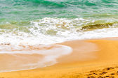 Waves of the sea on sandy yellow beach — Stock Photo