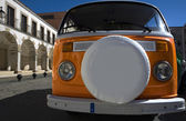 A classic orange van spare tyre cover — Stock Photo