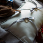 Wedding rings on cushion — Stock Photo #37814815