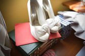 Books and bride shoes — Stock Photo