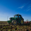 Farmer plowing field — Stock Photo #39070865