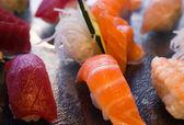 Sushi over black slate tray — Stock Photo