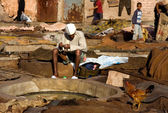 Worker on old tannery — Stock Photo
